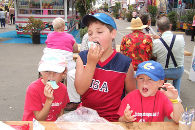 Sydney, Zandler and Christopher chowing down on cotton candy at the 2005 Ventura County Fair.