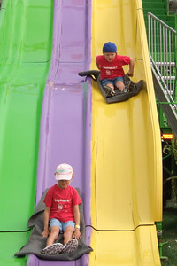 Sydney & Christopher zipping down the slide at the 2005 Ventura County Fair.