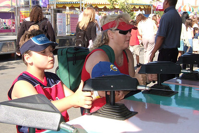 Zandler and Bev demonstrating their expert marksmanship at the 2005 Ventura County Fair.
