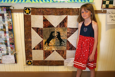 Sydney with her favorite quilt (Horse-Play) at the Valley Heritage Days celebration.