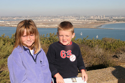 Sydney and Christopher at Cabrillo National Monument enjoying the view toward North Island and San Diego.