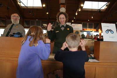 Ranger Patricia swearing in two new Junior Rangers at the Cabrillo National Monument.