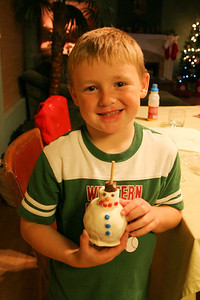 A candied apple snow man made by the mother of one of Christopher's classmates. The head is a marshmellow. Pretty neat idea!