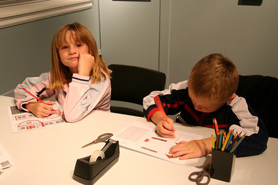 Sydney and Christopher working on scale-model buildings for the new railroad exhibit at the Fort Collins Museum.