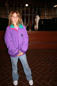 Sydney in front of a Clydesdale horse in the Clydesdale Hamlet at the Anheuser-Busch brewery in Fort Collins.