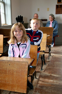 Grandma, Papa, Sydney and Christopher checking out the Upper Boxelder School, a one-room school house built in 1905, that is now located on the grounds of the Fort Collins Museum.