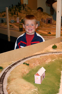 Christopher and the building he made that was added to the new railroad exhibit at the Fort Collins Museum.