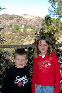 After having breakfast with Mickey and Minnie Mouse and enjoying a Disney Holiday Spectacular at the El Capitan Theatre, we went for a drive in the Hollywood hills. The Hollywood sign is on the hill behind Christopher and Sydney.