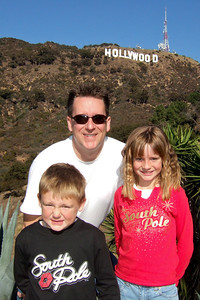 After having breakfast with Mickey and Minnie Mouse and enjoying a Disney Holiday Spectacular at the El Capitan Theatre, we went for a drive in the Hollywood hills. The Hollywood sign is on the hill behind Pat, Christopher and Sydney.