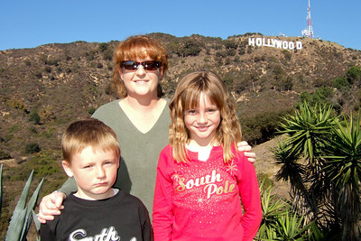 After having breakfast with Mickey and Minnie Mouse and enjoying a Disney Holiday Spectacular at the El Capitan Theatre, we went for a drive in the Hollywood hills. The Hollywood sign is on the hill behind Kathy, Christopher and Sydney.