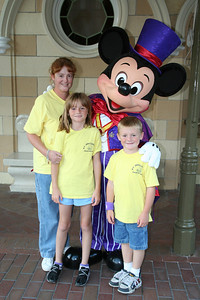 Kathy, Sydney and Christopher with Mickey Mouse in Disneyland.
