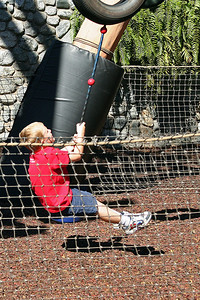 Christopher enjoying the rope ride in the Redwood Creek Challenge Trail area of Disney's California Adventure Park.