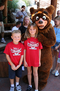 """Christopher and Sydney with Koda after """"The Magic of Brother Bear"""" show at Disney's California Adventure Park."""