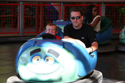 """Christopher and Pat enjoying Tuck and Roll's Drive'Em Buggies at Disney's California Adventure Park. At P.T. Flea's circus, the acrobatic Tuck 'n' Roll, from Disney/Pixar's """"a bug's life"""" put on quite a show and you are along for the ride."""