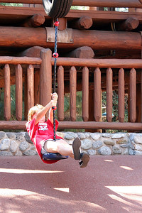 Sydney enjoying the rope ride in the Redwood Creek Challenge Trail area of Disney's California Adventure Park.