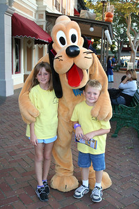 Sydney and Christopher with Pluto in Disneyland