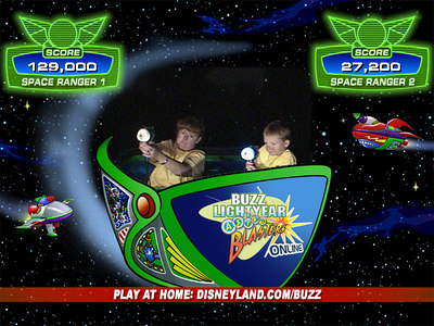 Recruits Kathy and Christopher in the midst of battle in the Buzz Lightyear Astro Blasters ride, where we piloted our Star Cruiser through treacherous terrain while zapping enemy targets and racking up points in an interactive and intergalactic battle against the Evil Emperor Zurg.