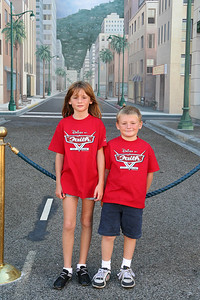 """Sydney and Christopher standing in front of the """"El Capitan Theatre on Hollywood Boulevard,"""" as recreated in Disney's California Adventure Park."""