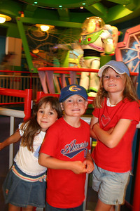Rachel, Christopher and Sydney at the Buzz Lightyear Astro Blaster ride