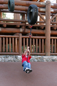 Sydney enjoying the rope ride in the Redwood Creek Challenge Trail area of California Adventure.