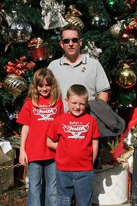 Pat, Sydney and Christopher enjoying Disneyland on Christmas day.