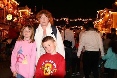 Kathy, Sydney and Christopher on Disneyland's Main Street on Christmas day.