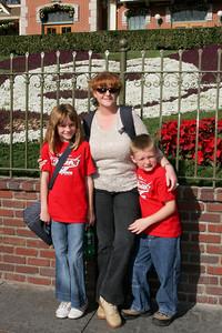 Kathy, Sydney and Christopher enjoying Disneyland on Christmas day.