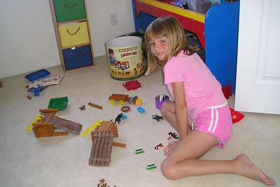 Sydney having fun with the Lincoln Logs in Christopher's bedroom.