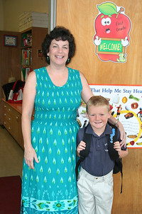 Christopher and his first grade teacher, Mrs. Beyer, on his first day at St. John's Lutheran School.