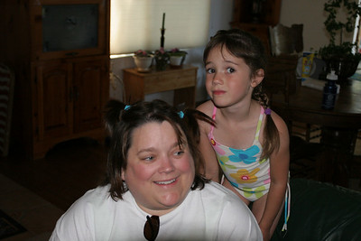 Rachel helping Aunt KK fix her hair at the Roth house