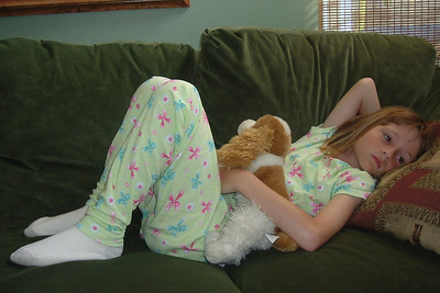 Sydney relaxing on the couch with Polly, one of her many stuffed animals.