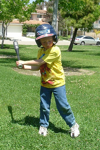 Christopher getting in a little batting practice in the park across the street from the house.