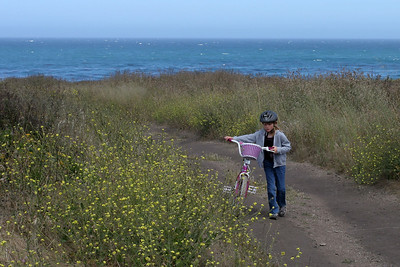 The hill was just a little too long for Sydney as she walks her bike along a trail in Montaña de Oro State Park.