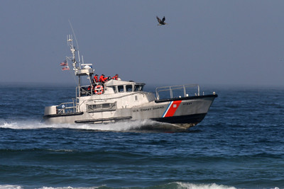 U.S. Coast Guard 47-foot Motor Lifeboat (MLB) cruising the coast off Morro Strand State Beach.   Vessel information from the USCG web site:   Special Characteristics: Self-righting (if overturned, the vessel will return to an upright position in 8 seconds or less).   The 47' motor lifeboat is designed as a first response rescue resource in high seas, surf & heavy weather environments. They are built to withstand the most severe conditions at sea and are capable of effecting a rescue at sea even under the most difficult circumstances. They are self-bailing, self-righting, almost unsinkable, and have a long cruising radius for their size. It is the replacement for the aging 44-ft MLB fleet.