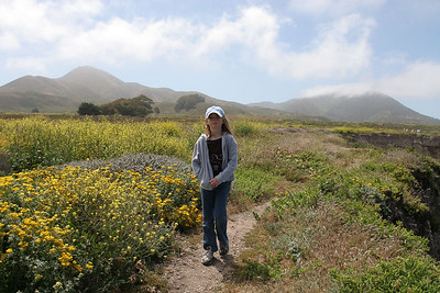 Sydney enjoying the view on the bluff above Corallina Cove in Montaña de Oro State Park.
