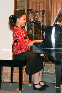 Alanna playing the piano during the music recital for Ms. Krumdiek's students.