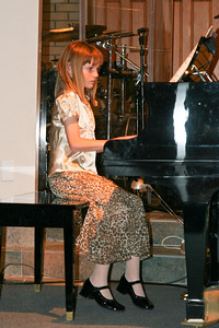 Sydney playing the piano during the music recital for Ms. Krumdiek's students.
