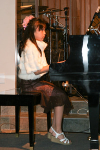 Sierra playing the piano during the music recital for Ms. Krumdiek's students.