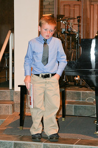 Christopher introducing himself to the audience before playing the piano during the music recital for Ms. Krumdiek's students.