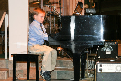 Christopher playing the piano during the music recital for Ms. Krumdiek's students.