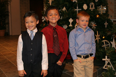 Eli, Jaison and Christopher after their great job playing during Ms. Krumdiek's music recital.