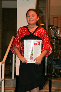 Alanna introducing herself to the audience before playing the piano during the music recital for Ms. Krumdiek's students.