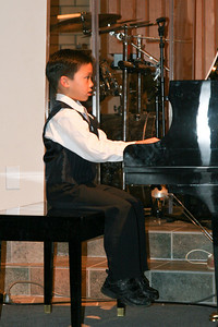 Eli playing the piano during the music recital for Ms. Krumdiek's students.