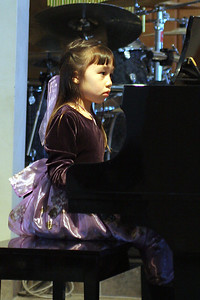 Sierra playing the piano during her recital