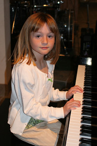 Sydney loves to play the piano and she is doing quite well at it.