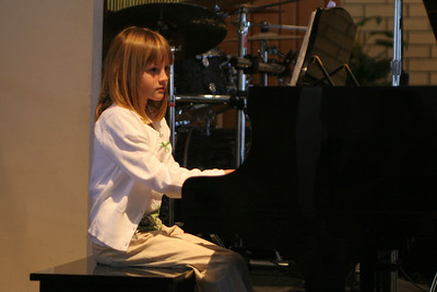 Sydney playing the piano at her recital