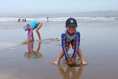 Christopher and Sydney digging for clams and enjoying the beach during our camping trip to Pismo State Beach's North Beach Campground.