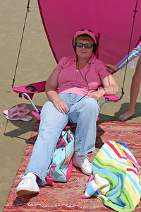 Kathy relaxing on the beach during our camping trip to Pismo State Beach's North Beach Campground.