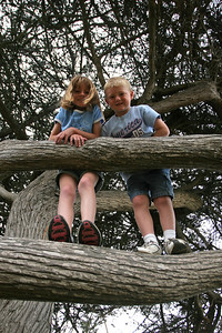 Sydney and Christopher posing in the trees in the North Beach Campground at Pismo State Beach.