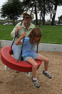 Kathy and Sydney getting ready to jump off on one of the rides in the playground in the Oceano Memorial Park.